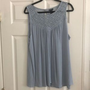 Blue sleeveless blouse with design
